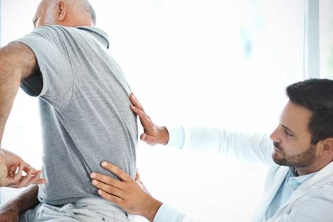doctor treating lower back and spine